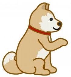 「こちらです」と指をさしている犬