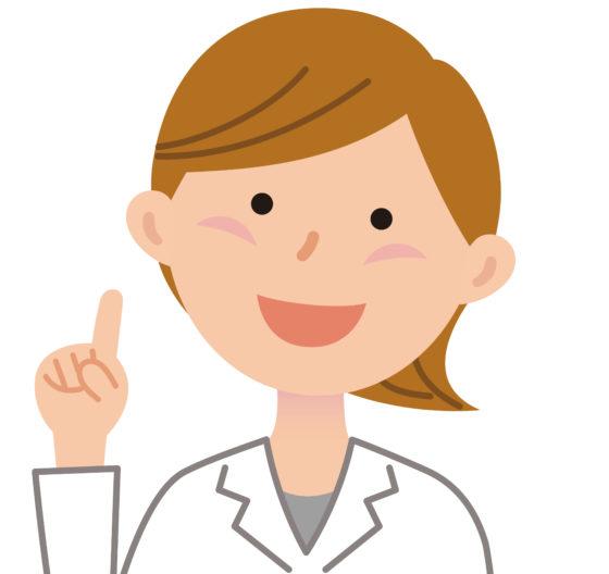 笑顔で指をさす女性の獣医
